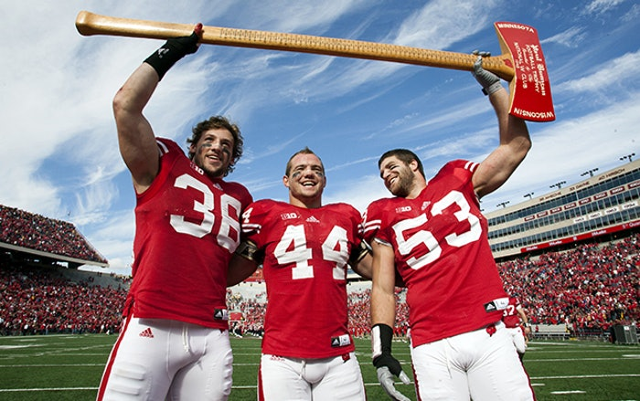 Chris Borland, middle, celebrates a Wisconsin Badgers victory over Minnesota. Borland, 24, is retiring from the NFL after just one season citing concerns over his health. (Photo by Brian Ebner)