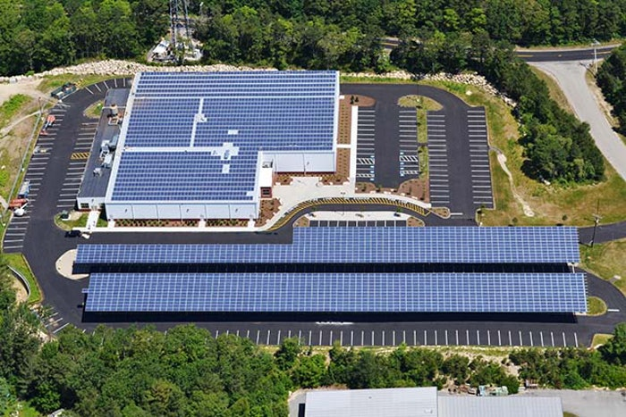 Falmouth Ice Arena's 3,300 solar panels, split between the rink's roof and a large parking lot carport, combine to produce roughly 900,000 kilowatt hours per year.