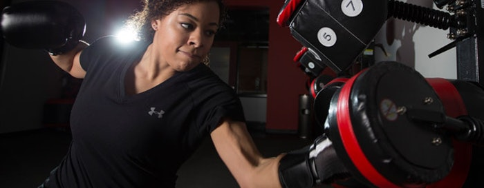 How Missouri and Oregon are capitlizing on the latest fitness programming trends, such as boxing, at their campus recreation facilities. (Photo by David Freyermuth for MizzouRec.)