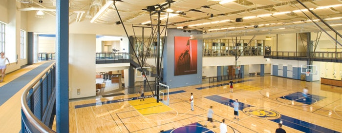 SOUND DESIGN The gymnasium at the Shepherd University Student Wellness Center was designed for change. The acoustic panels, multi-level lighting and flexible sound and power distribution allow it to quickly change to accommodate sporting and recreation programs, as well as social events. (photo By Myro Rosky/Rosky & Associates Inc.)