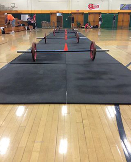 CrossFit event damages wood sport court [Image courtesy WoodFloorBusiness.com]