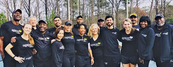 Agape Tennis Academy staff pose for a photo at DeKalb Tennis Center. [Photos courtesy of Agape Tennis Academy]