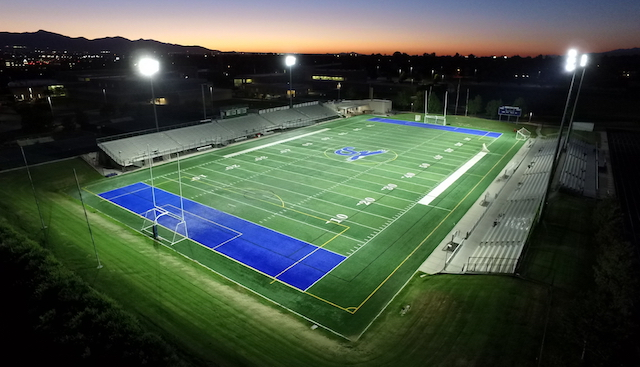High school football field lit by LED Sports Lighting
